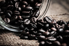 Coffee beans in glass jar Stock Images
