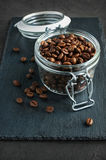 Coffee beans in a glass jar Stock Images