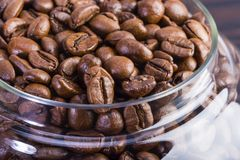 Coffee beans in a glass jar Royalty Free Stock Photos