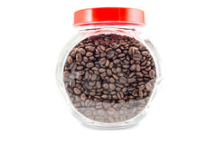 Coffee beans in the glass jar isolated on white Stock Photos