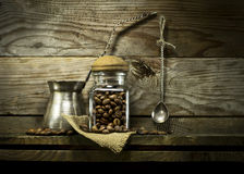 Coffee beans in a glass jar and spoon on shelf. Stock Photo