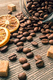 Coffee beans into glass jar table with sugar and anise Royalty Free Stock Photography