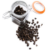 Coffee beans in a glass jar on white background. ! Royalty Free Stock Image