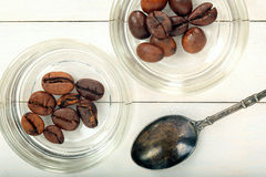 Coffee beans in glass jars with vintage spoon Stock Photography