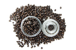 Coffee beans in glass. White background royalty free stock photography