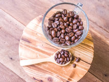 Coffee beans on a glass Stock Images