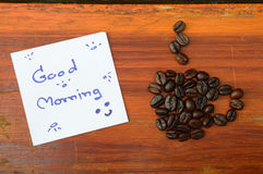 Coffee beans and good morning note Royalty Free Stock Image