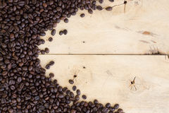 Coffee beans on grain wood Stock Photography