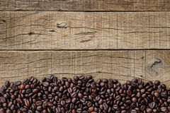 Coffee beans on grain wood Royalty Free Stock Photo