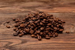 Coffee beans. Grains of coffee in the colors brown parched sun Royalty Free Stock Images