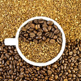 Coffee beans and grains in a white cup Stock Photos