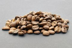 Coffee beans on gray background stock photos