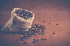 Coffee Beans on Gray Sack Stock Images