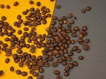 Coffee beans on a gray and yellow background royalty free stock images