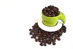 Coffee beans in green cup Royalty Free Stock Photos