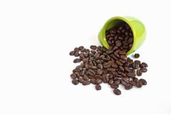 Coffee beans in green cup Stock Photo