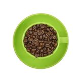 Coffee beans in a green cup Stock Images