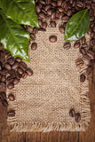 Coffee beans and green leaves Royalty Free Stock Photo