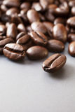 Coffee Beans on Grey Ceramic Surface Stock Photo