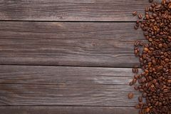Natural coffee beans on grey wooden background stock photography