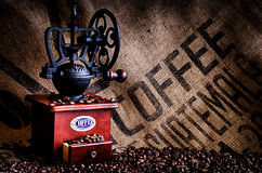 Coffee Beans and Grinder with Bag Closeup Royalty Free Stock Images