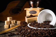 coffee beans with grinder and coffee cup Royalty Free Stock Image