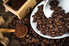 Coffee beans with grinder and coffee cup Stock Photography