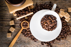 coffee beans with grinder and coffee cup Stock Images