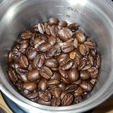 Coffee Beans in the grinder. A collection of coffee beans in a coffee grinder Stock Photography