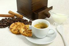 Coffee beans grinder and hot cup of on white background Stock Photography