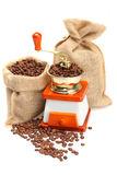 Coffee beans, grinder and sack. Coffee grinder, beans and sack on white background stock image