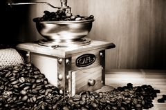 Coffee beans and grinder on sacking. On vintage Stock Photography