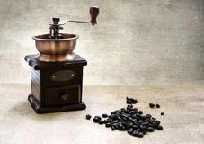 Coffee beans and a grinder textured background Stock Photography