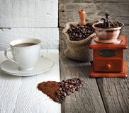 Coffee beans and grinder Stock Photos