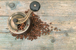 Coffee beans and  grinders on old wooden table Stock Image