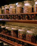 Coffee beans on grocery shelves. Different coffee sorts are present on grocery shelves. Coffee beans are placed into the glass bottles Stock Image