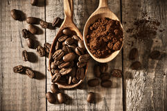 Coffee beans and ground close-up Stock Photography