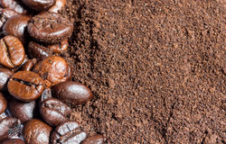 Coffee beans and ground coffee background Royalty Free Stock Photo