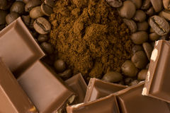 Coffee beans, ground coffee with chocolate bars Stock Image