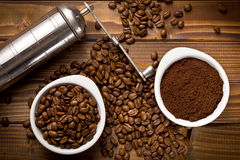 Coffee beans with ground coffee and grinder Stock Image