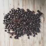 Coffee beans and ground coffee on a table from above Royalty Free Stock Photography