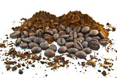 Coffee beans and ground coffee. On a white backgroundnnncoffee ,beans ,white ,background, flavory,delicious ,rich, black,cinnamon Stock Image