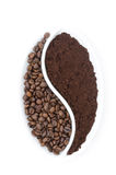 Coffee beans and ground coffee in a white plate Stock Photos