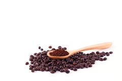 Coffee beans and ground coffee on wooden spoon isolated on white Royalty Free Stock Photos