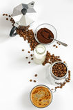 Coffee beans and ground, milk in a bottle, Moka pot Royalty Free Stock Image