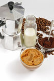 Coffee beans and ground, milk in a bottle, Moka pot Royalty Free Stock Photos