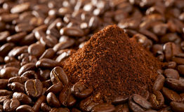 Coffee beans and ground pile, perfect for backdrop Royalty Free Stock Photo