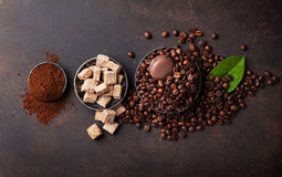 Coffee beans, ground powder and brown sugar Stock Images
