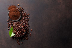 Coffee beans and ground powder Stock Images