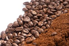 Coffee Beans and Grounds background.Roasted coffee beans and grounds close up from above selective focused